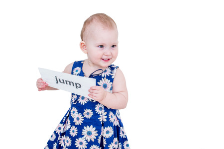 Little girl holding a card with the word jump
