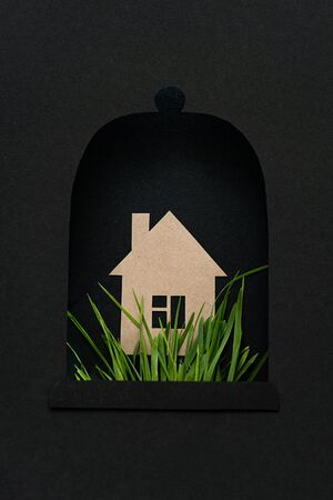 Emergency concept. Paper bell with house in the middle and green grass under it. All in black colors. 3d illusion.