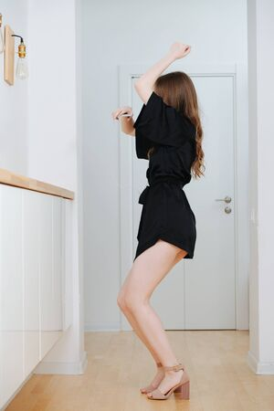 Woman dancing, having boost of energy in the morning after getting up.