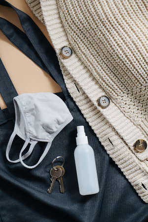 Anti-covid kit to go outside. Cotton bag, cardigan, sanitiser, mask and keys