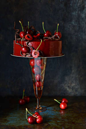 Black Forest mousse chocolate cake with red mirror glaze and fresh cherries. A modernized classic dessert. Zdjęcie Seryjne